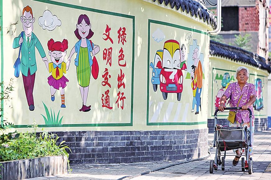 路附近,一组以城市文明为主题的宣传漫画十分醒目.-济南文明网